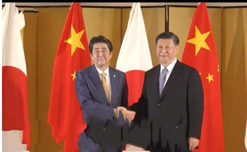 习近平会见日本首相安倍晋三并出席安倍举行的晚宴